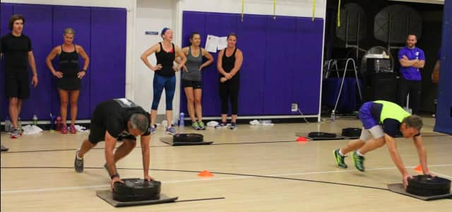 Participants compete in the #plate #plank event at last year's Y Games