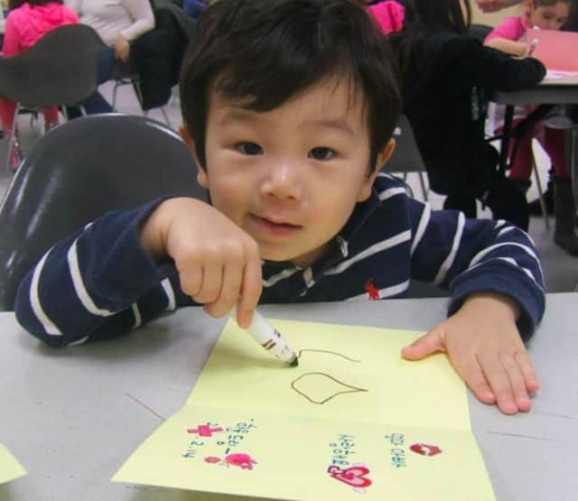 A youngster makes a Valentine's Day card at the Leonia Library.