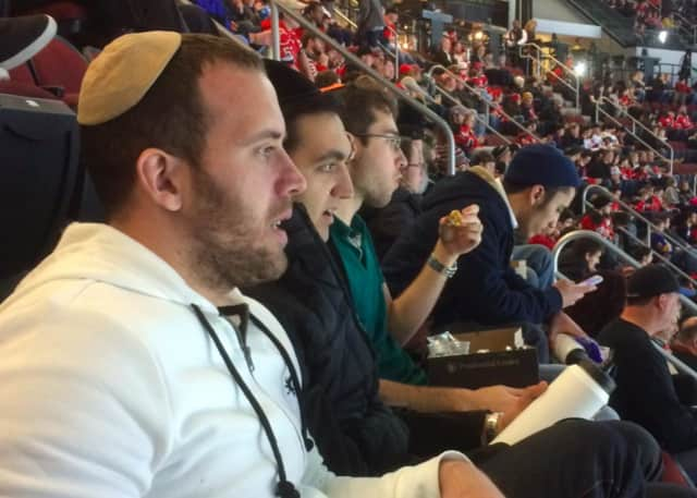 Students in the Fairleigh Dickinson University Yeshiva Program attend a New Jersey Devils game Tuesday night.
