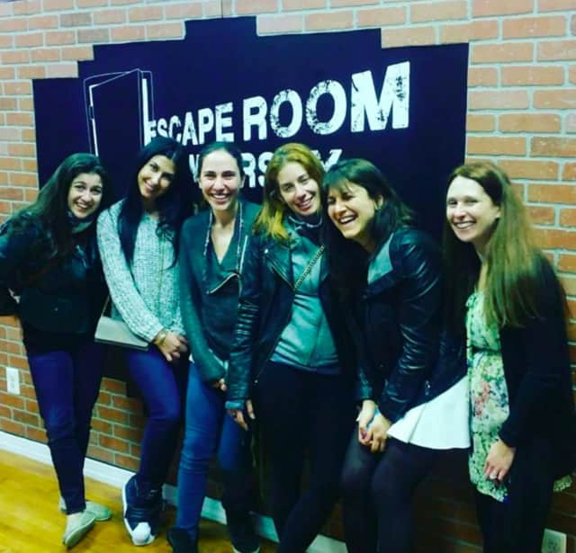 Escape Room NJ team members smile because they made it out.