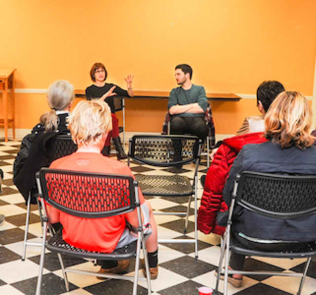 """Claire Kelly, director of Shakespeare on the Sound production of """"Hamlet"""" and Joey Santia, who plays the title role, address a group assembled in the Moose Room of the Rowayton Community Center."""