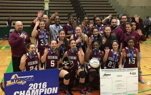Ossining High School's girls basketball team celebrates its fourth straight NYSPHSAA title.