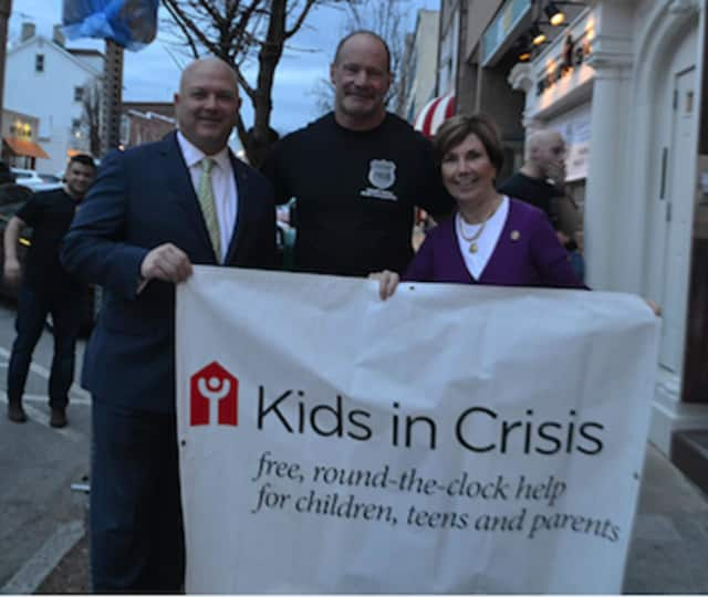 "State Representatives Livvy Floren (R-149) and Mike Bocchino (R-150), pictured with Lt. Rick Cochran, showed their support for Kids in Crisis March 10 at ""Tip A Cop,"" held at Sundown Saloon."