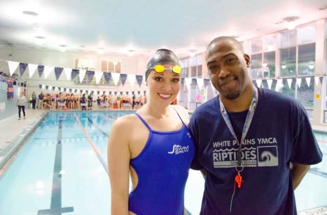 Terrance Ewuell, right, the Aquatics Director at the White Plains YMCA, meets 2008 and 2012 Olympian Chloe Sutton after a recent swim clinic at the Y.