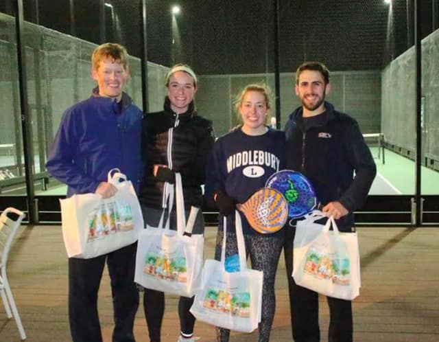 Tournament flight winners Will Oberrender and Brittney Faber with runners up Patrick O'Callaghan and Margaret Souther.