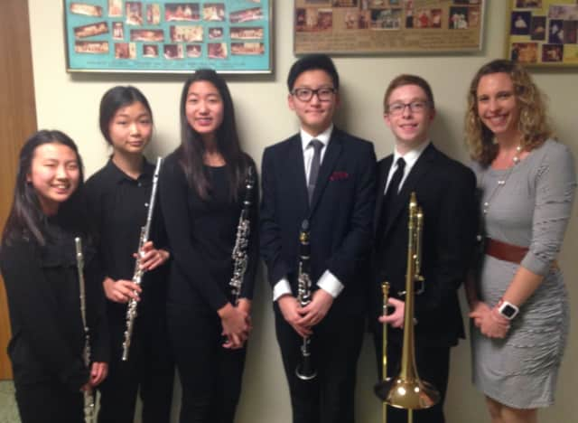 From left: Minhee Han, Jeannie Jeon, Kayla Yi, Austin Yang, Charles Hall and band director Amy Wilcox