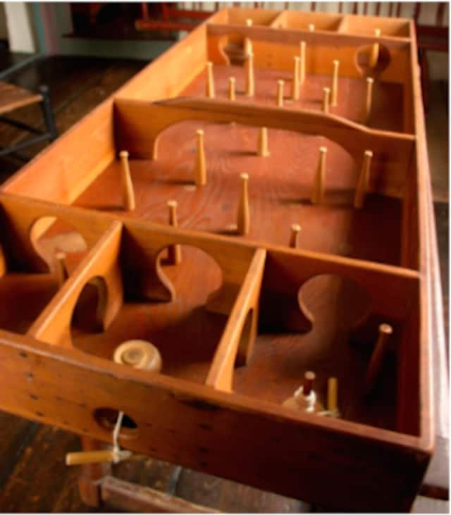 Games like this tabletop Skittles games were typical of those played in colonial taverns.
