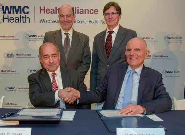 In front are Michael D. Israel, CEO of Westchester Medical Center and David Scarpino, President and CEO HealthAlliance. Standing from left, are Mark Tulis, Vice Chair, Westchester Medical Center and Thomas Collins, Chairman, Health Alliance.