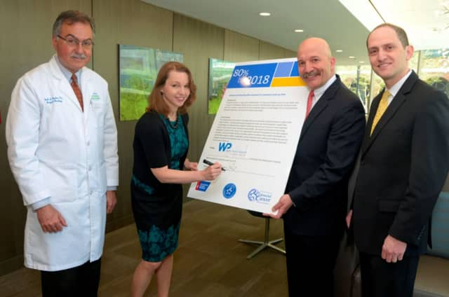 WPH President and CEO Susan Fox signs the pledge with, from left to right: Dr. Mark Gordon, Surgical Director of the WPH Cancer Program; Frank LoCastro PhD, Wellness Program Coordinator; and Dr. Joshua Raff Director of the Digestive Cancer Program.