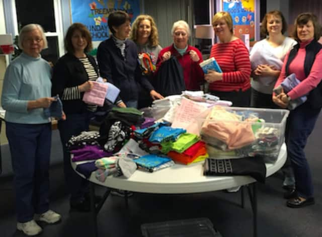 The women of St. Michael's Lutheran Church recently made kits for Lutheran World Relief. Pictured (left to right): Evelyn Ness, Laura White, Mary Runestead, Jeannette DiBerardino, Judy Moist, Kathy Mitchell, Sarah Pflueger and Pauline Doenges.