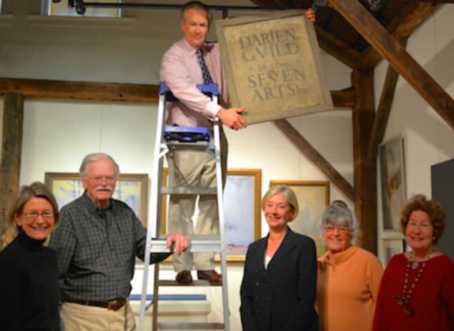 """Committee members prepare for the Darien Historical Society's upcoming exhibit, """"Darien 1925-1950 ~ Golden Age of Art and Design."""""""
