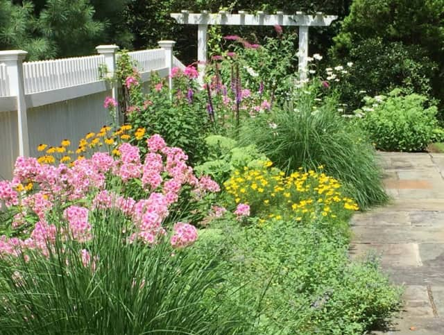 Get your perennial garden blooming this spring with some tips from Lawler Landscaping.