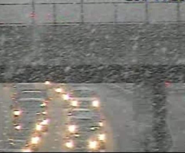 Light snow falls on the Tappan Zee Bridge span just after 7:30 a.m. Monday.