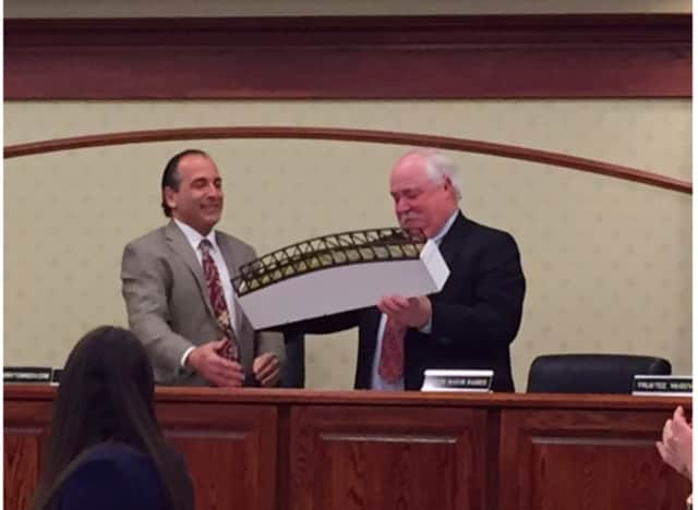 Mayor Fixell presents Tom Basher with a replica of the footbridge.