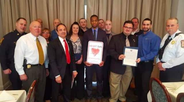 Mayor Joe Ganim, front row, second from left, accepts a state plaque declaring Bridgeport a HEARTSafe community.