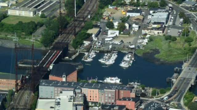An aerial view looking east shows the Walk Bridge on the left and the Stroffolino Bridge on the right, spanning Norwalk Harbor.