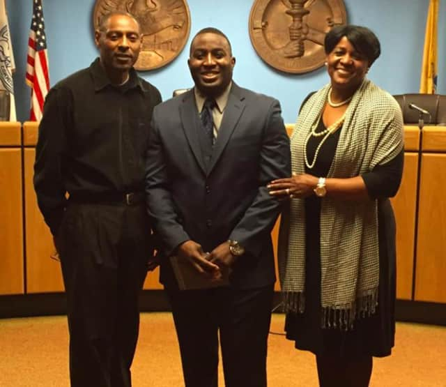 New Lodi Police Officer Derrick Morrison with his parents.