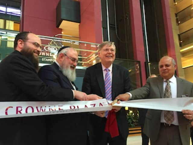 The Crowne Plaza Hotel at 2701 Summer St., Stamford, celebrated its grand re-opening Wednesday. From left: Rosdev Group's Thomas Rosenberg and Michael Rosenberg, Mayor David Martin and hotel general manager Sanj Rai.