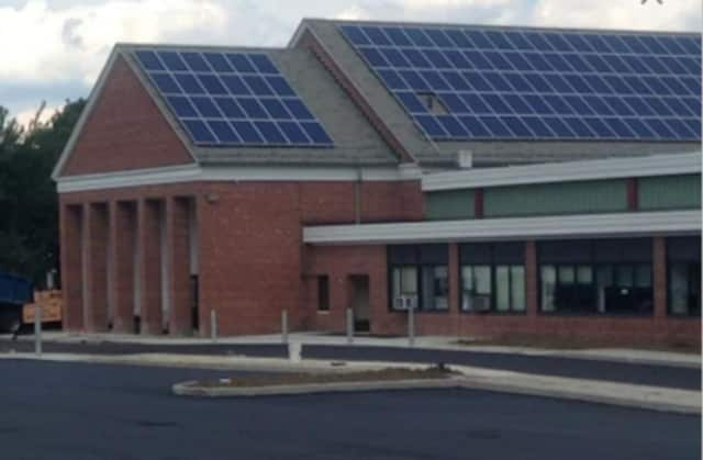 A Danbury first-grade student said a classmate threatened to bring a gun to school and shoot him.