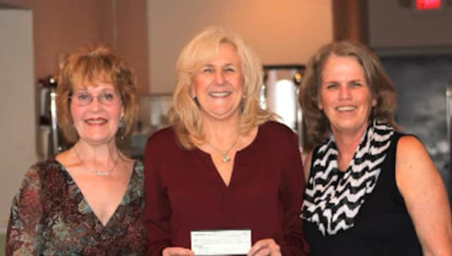 (left to right) Karen Rauch, Book and Needle Woman's Club treasurer; Jean Kirsh, director of development for the Center For Hope and Safety; Mary Cioffi, Book and Needle Woman's Club president