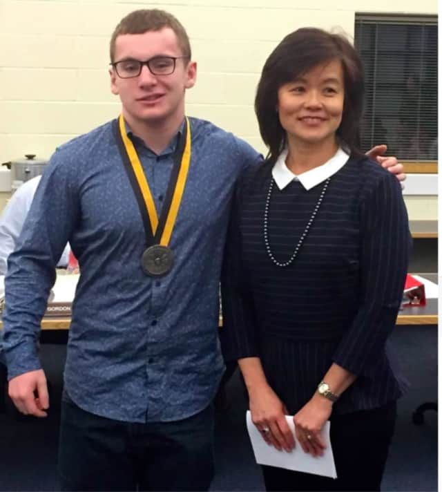 Benjamin Zangola received a medallion from Prudential Financial Advisor Lily Lam