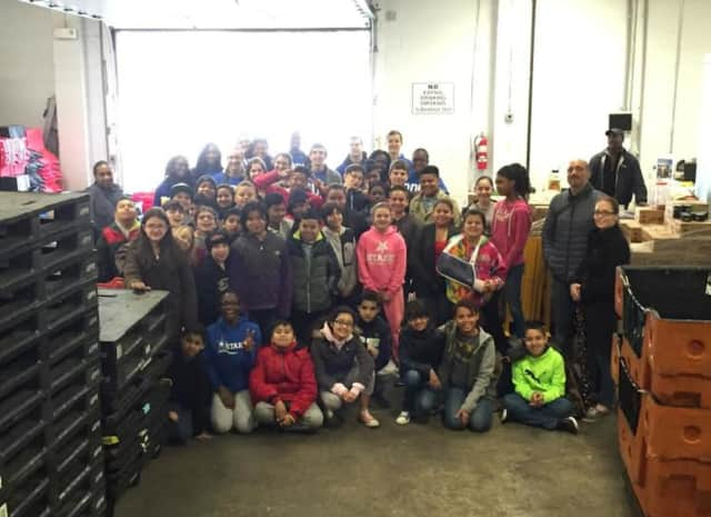 SPEF students get involved in service learning at the Food Bank of Lower Fairfield County April 12.