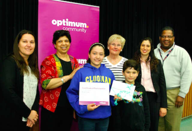 """Aline Correa, third from left, a sixth-grade student at Cloonan Middle School, is a finalist in Optimum Community's inaugural """"Black History Month"""" essay contest."""