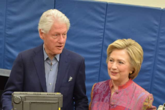 Hillary and Bill Clinton arrive at Chappaqua's Douglas G. Grafflin Elementary School to cast her votes for New York's Democratic presidential primary.
