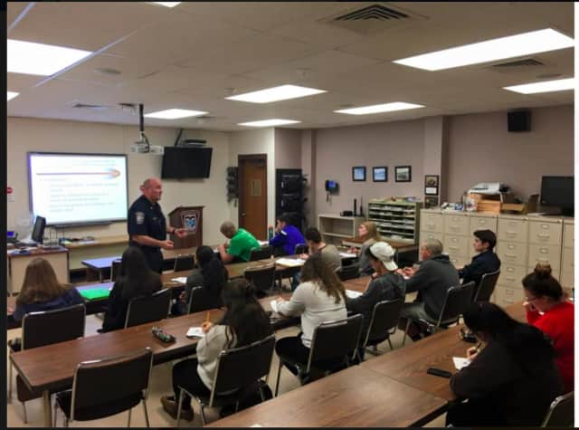 Major James Purcell of the Brookfield Police Department discusses the risks, dangers, consequences and laws surrounding Driving Under the Influence of drugs and/or alcohol with a group of Driver's Education students.