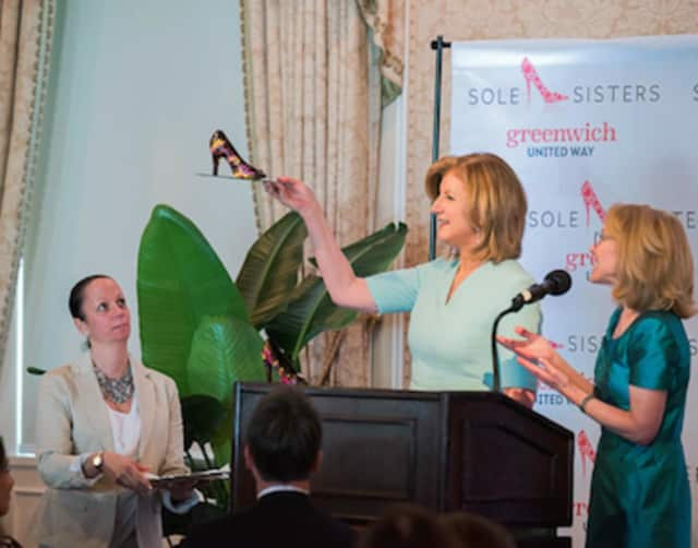 Arianna Huffington has a new pair of chocolate shoes after appearing for a Greenwich speech. With Huffington is Greenwich United Way Board Chairman Karen Keegan.
