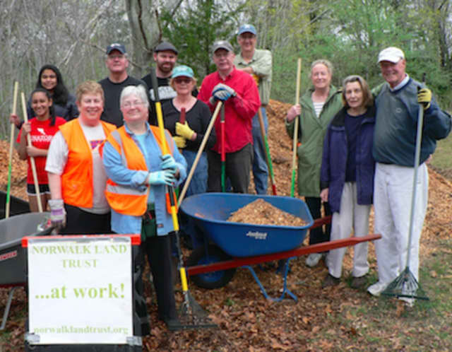Volunteers gathered by the Norwalk Land Trust at the Farm Creek Preserve in Rowayton to clean up debris and put down mulch.