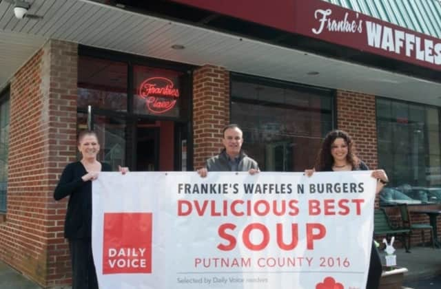 This is the banner that was stolen from Frankie's Waffles & Burgers in Mahopac. Above, Carina Evangelista, far right, and Marian Feliciotto of Frankie's with Daily Voice Director of Media Initiatives/Managing Editor Joe Lombardi in March.