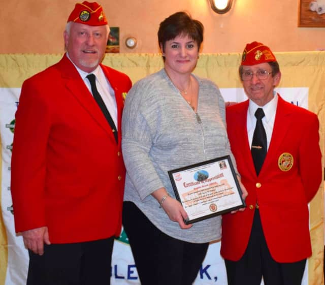 Marilyn Nasello, president of Saddle Brook UNICO, with U,S. Marine Corps reps Ed Ebel and Vince Montagna.