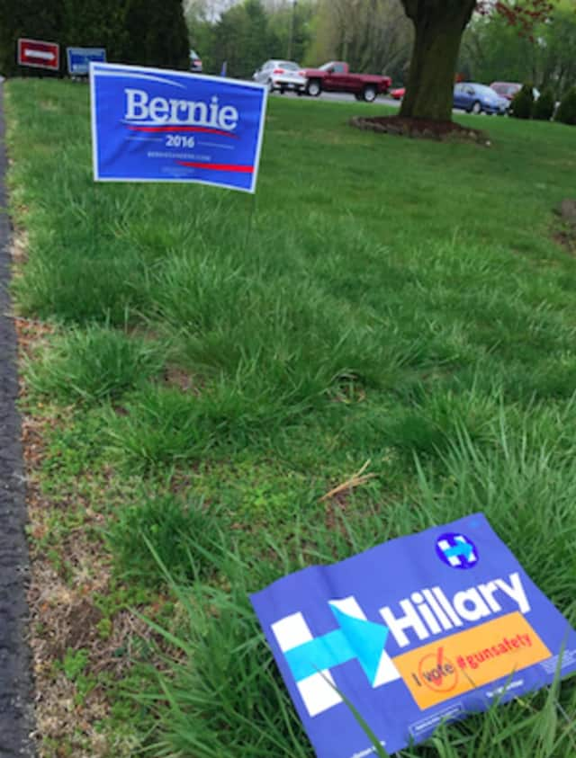 Campaign signs outside the polling place for District 6 in Stamford at St. Bridget of Ireland Church.