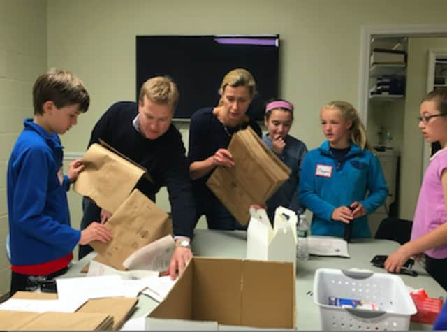 Volunteers prepping grocery bags for Postal Service Food Drive at Person-to-Person during  Kyle A. Markes Day of Service on April 16. The organization received a $10,000 grant from Pepperidge Farm, a subsidiary of Campbell Soup Company.