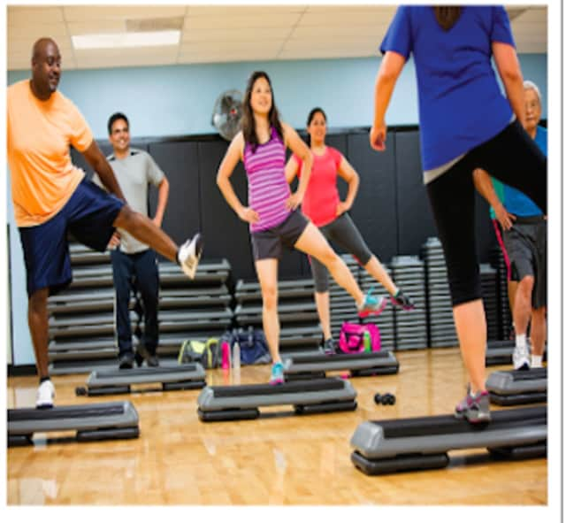 """Adults taking a step class at the Brookfield YMCA. The Regional YMCA of Western Connecticut in Brookfield and a Greater Danbury Coalition called """"Getting There"""" have convened to raise interest on the importance of physical activity."""