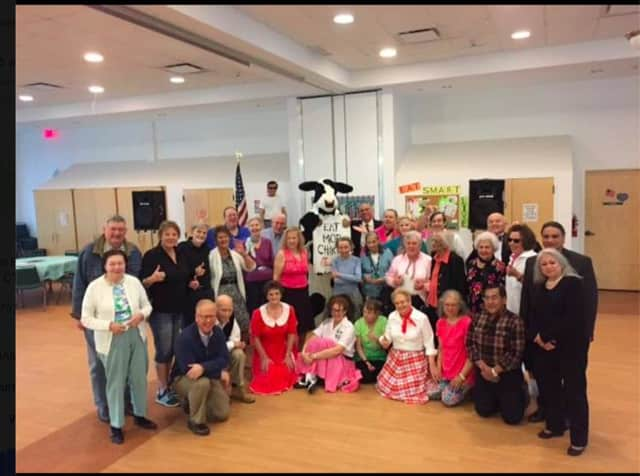 The Danbury Senior Center recently held a sock hop. Danbury Mayor Mark Boughton (kneeling, far left) attended the event. Staff members from Chick Fil A in Brookfield also attended.