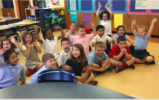 Students as young as these Lordship Elementary School first-graders class are learning about money management during Financial Literacy Month in Stratford.