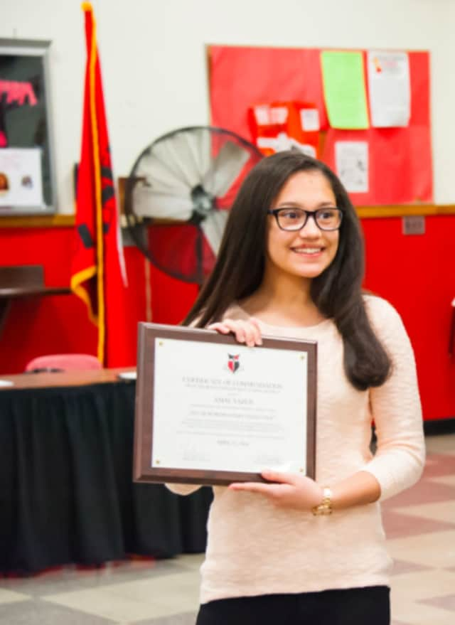 Amal Yazej receives her certificate of commendation from the Bergenfield Board of Education.