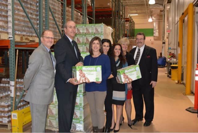 The Junior League of Westchester supports the diaper bank among projects. Shown here is the Westchester Diaper Bank receiving a Huggies donation of 90K diapers, warehoused by the Food Bank for Westchester.