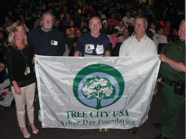 From left, Assistant Principal Laura Maher; Karl Witalis, president emeritus of the land trust; Tony DeCarlo, who provided the seeds from his Newtown orchard; First Selectman Steve Vavrek and Ranger Dave who organized the ceremony.