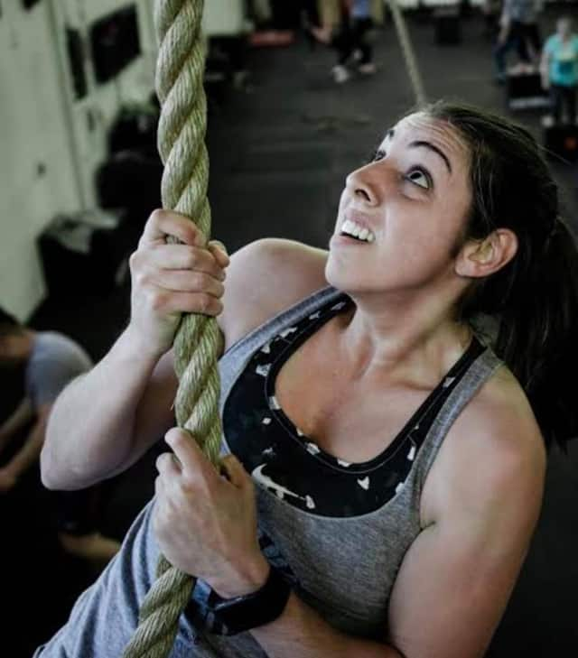 State Trooper Dana Wilcomes climbs a rope in Guerrilla Fitness Paramus.