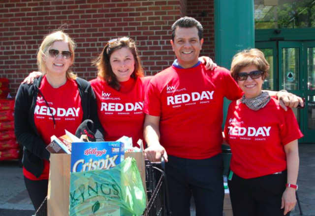 Bita Ameri, Jennifer Kirschen-Hamani, Jamie Miller and Luis Carlos at last year's RED Day. The associates collected food and donated it to veterans.