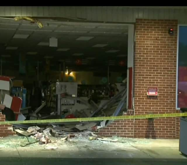 A look at the damage to the CVS in the Triangle Shopping Center after the car crashed into the building.