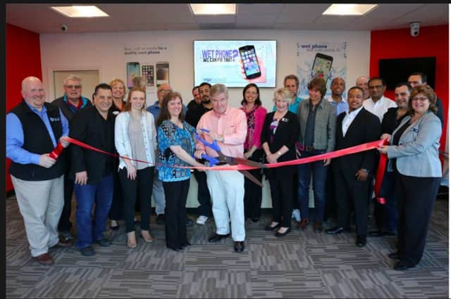The Brookfield Chamber of Commerce had a ribbon cutting ceremony to celebrate the opening of a new business called The Phone Specialists in Danbury.