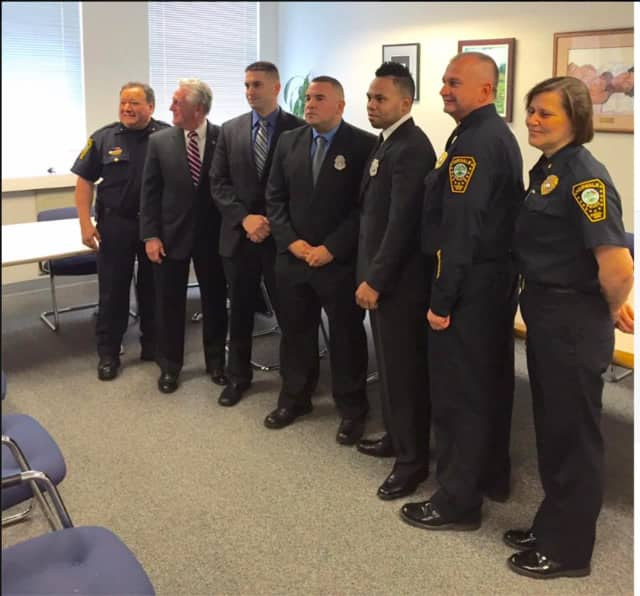 From left, DC Gonzalez, Norwalk Mayor Harry Rilling, Officer Brian Hamm, Officer Jaime Acosta, Officer Ariel Martinez, Chief Kulhawik and DC Zecca at the swearing-in ceremony.