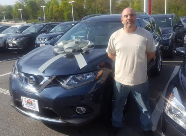 Ed D'Amico and his Nissan Rogue.