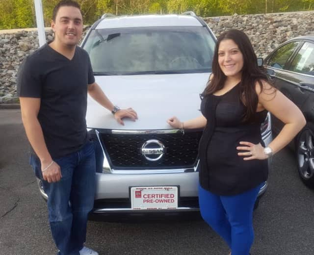 Giovanni and Rosaria Luciano with their 2015 Nissan Pathfinder.