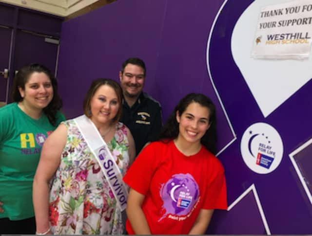 Westhill High School senior Silvana Cordona, right, joined from left: Grace Sinto, American Cancer Society, teacher and cancer survivor Danielle Waring and assistant principal PJ Wax. The Stamford school had its first Relay for Life event Friday.