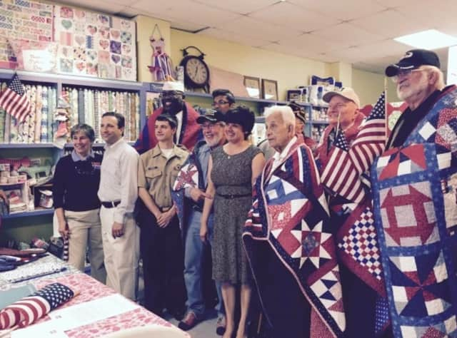 U.S. military veterans received quilts last year at Christie's Quilting Boutique in Norwalk as part of the Quilts of Valor program.